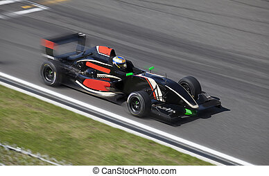 Formula 2 race car on a speed track with motion blur