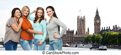 group of happy different women in london - friendship,...