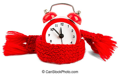 Alarm clock wearing red scarf Isolated on white background