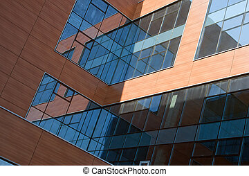 office building with red walls and blue windows