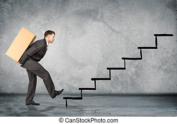 Middle aged business man with difficult task going up stairs