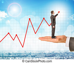 Man holds businessman drawing growth chart