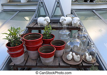 Decorative glass bottles and ceramic pots for plants