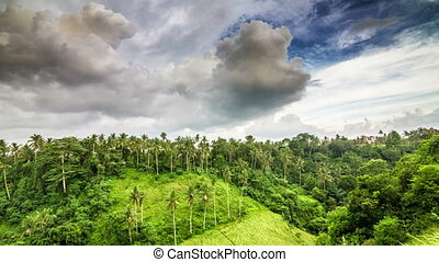 Evening clouds on hill in tropics time lapse - Evening...
