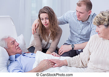 Family will never leave you - Shot of a senior man laying on...