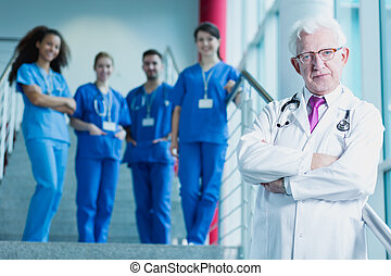 Im responsible for future doctors - Mature doctor in white...