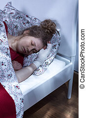 Lonely woman sleeping - Image of lonely blonde woman...