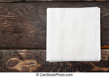 Paper  napkins on wooden surface