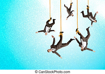 Businessmen hanging on ropes, place image of your product...