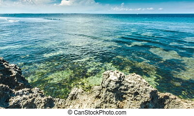 Ocean waves with rocks shore - Clear ocean waves with sharp...