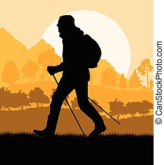 Man hiking in mountains adventure nordic walking with poles in nature