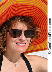 Attractive Woman wearing Summer Hat
