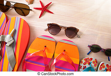 Sunglasses and flip-flops family beach top view - Sunglasses...