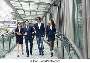 business people walking - Group of business people walking...