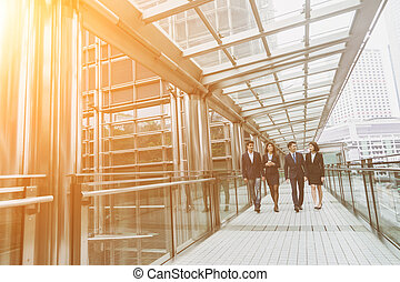 business people walking - Group of business people walking...