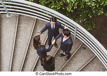 business people hand shaking - Top view of business people...