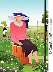 Senior Lady in a Flower Garden