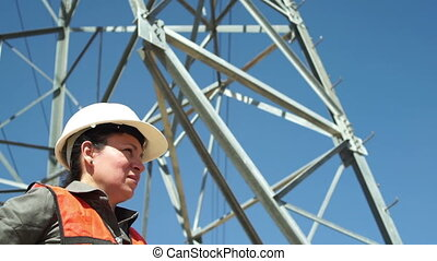 Electrical Pole Structure Workers - Close up low angle shot...