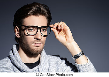 business style glasses - Imposing young man in spectacles....