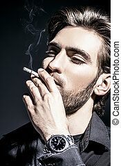 smoking a cigarette - Smoking young man Handsome young man...