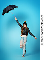 teen under umbrella - Happy teenager girl in spring clothes...
