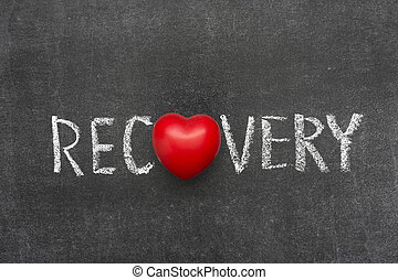recovery word handwritten on blackboard with heart symbol...