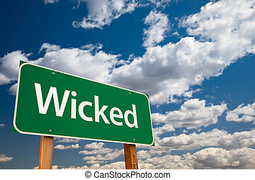 Wicked Green Road Sign with Sky