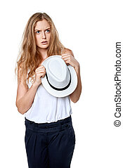 Displeased sullen woman holding straw hat looking away at...