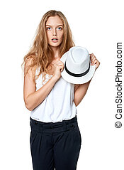 Surprised woman holding straw hat