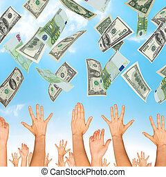 Many dollars falling on business people hands