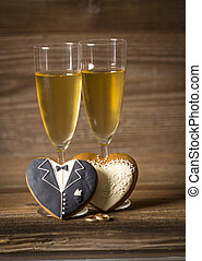 Glass filled with champagne and gingerbread hearts
