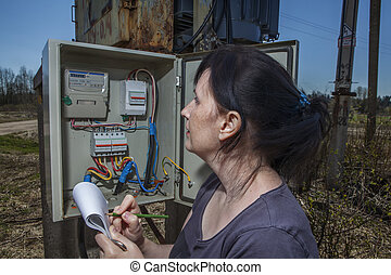 electrician engineer inspecting electric counter equipment in distribution fuse box