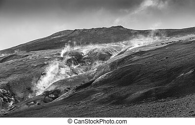 Krafla Mountain Ridge BW - Steaming rim of a volcanic lava...