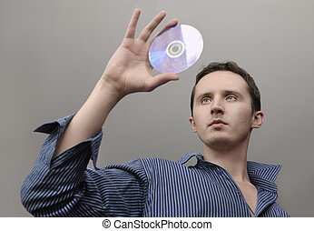 Man with compact disc