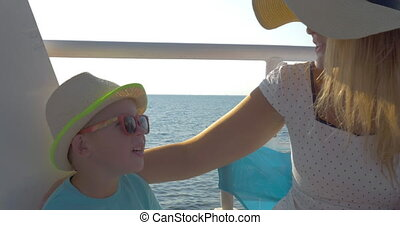 Mother and son traveling by ship