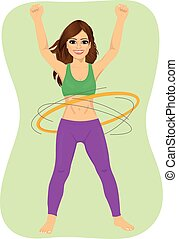 Young woman doing exercise with a hula-hoop Fitness woman...