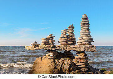 Several piles of stones - Balance a few stack of pebbles on...