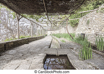 Old abandoned orangery. - Old stone orangery with water...