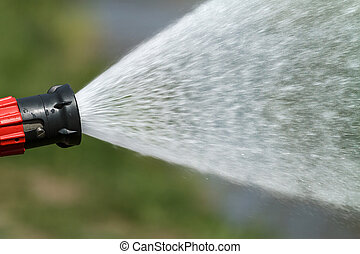 stream of water from a fire hose - jet of water under high...
