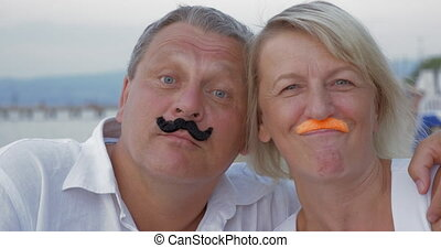 Funny senior couple with moustache - Close-up shot of a...