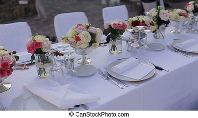Gorgeous wedding  table setting for fine dining outdoors.