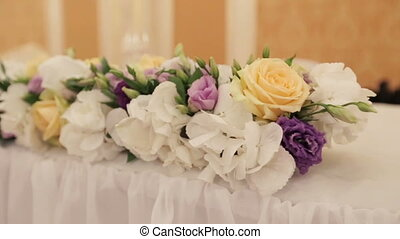 Beautiful flower decoration for the table setted for wedding celebration