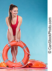 Lifeguard woman on duty with ring buoy lifebuoy - Happy...