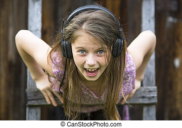 ittle girl with headphones - Emotional naughty little girl...