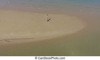 sea shallow landscape with ripple - aerial drone rotate...
