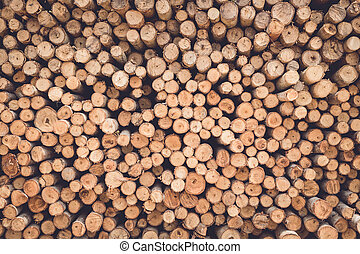 Stacked of wood log for construction buildings background...