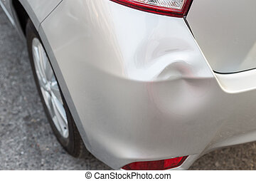 Backside of silver car get damaged by accident - Backside of...