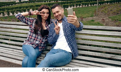Couple taking photo with cellphone on stairs in the city