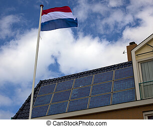 solar at the roof a dutch house with flag