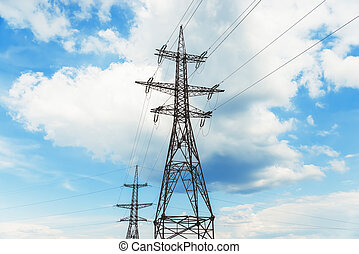 high voltage tower on clouds background